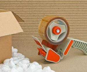 Tape gun and a box