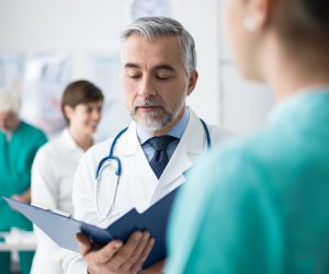 Doctor checking patient's medical records