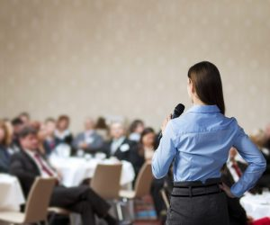 Business woman speaking at a corporate event