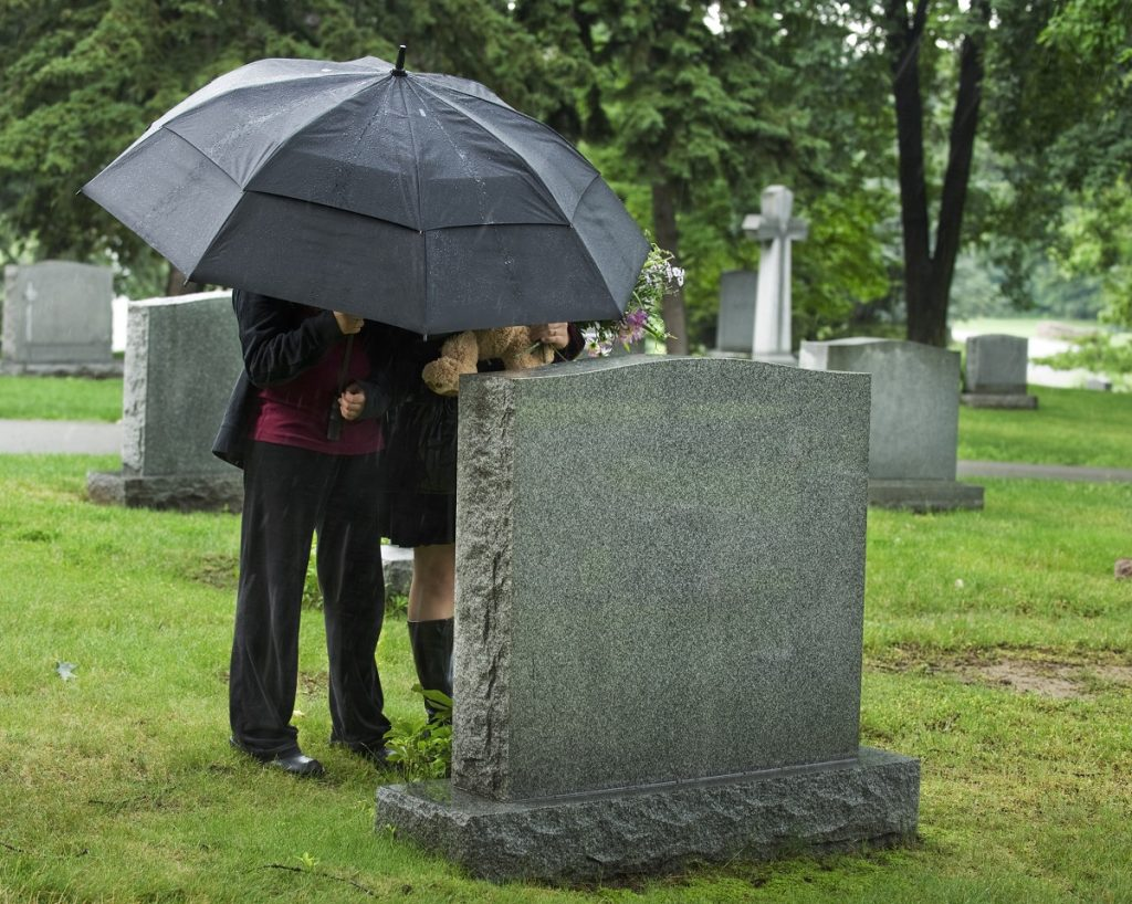 Family visiting the grave
