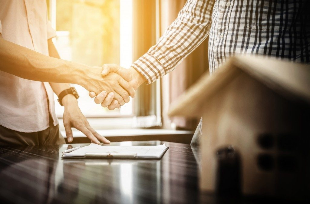 Real estate investors shaking hands