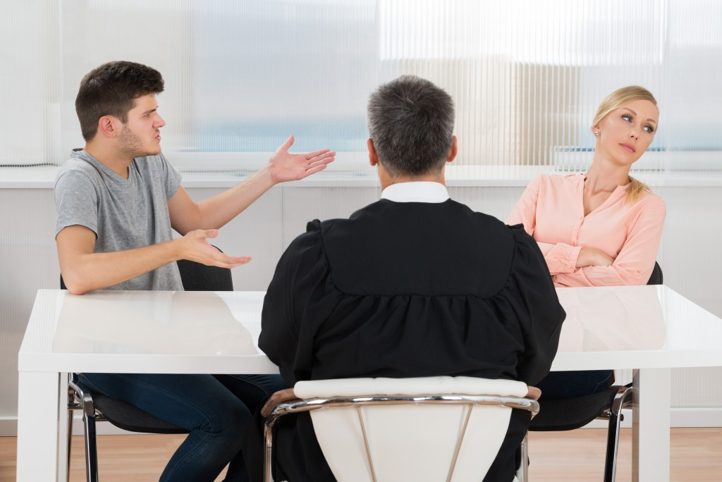 divorcing couple talking to their lawyer