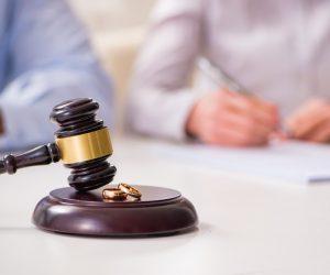 Judge gavel and wedding rings