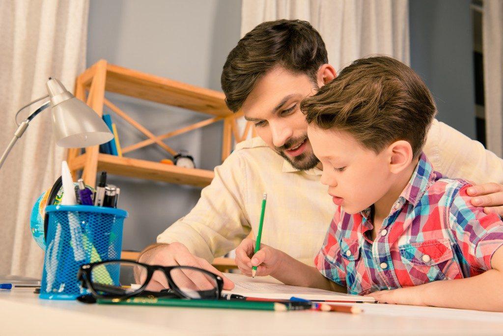 Single dad tutoring son