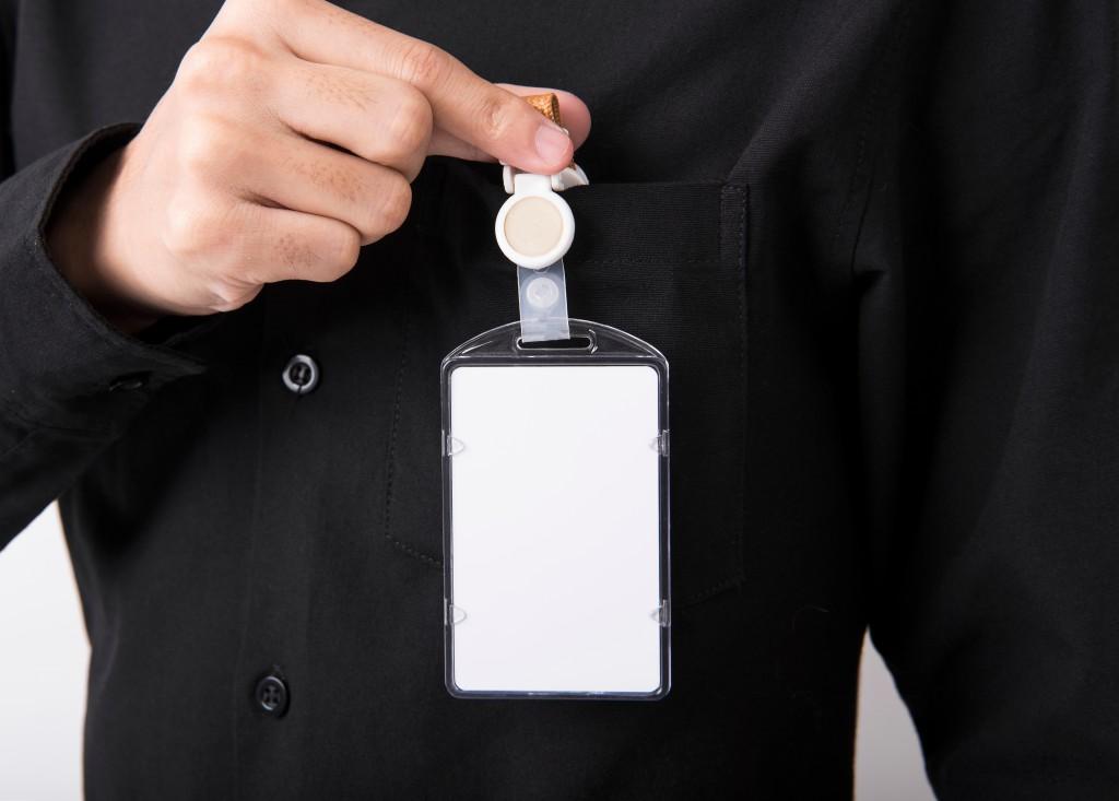 employee holding badge