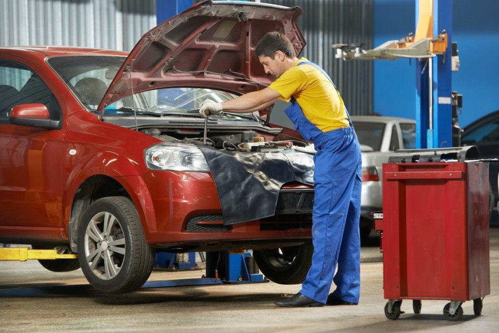 car maintenance at engine auto repair shop service station