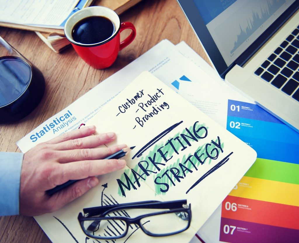 Marketing strategy written on a notebook