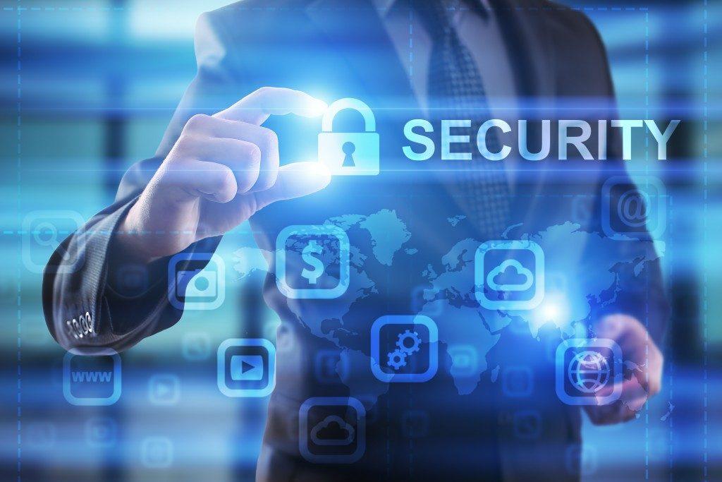 man holding digital security label