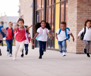 children happily going home on school break
