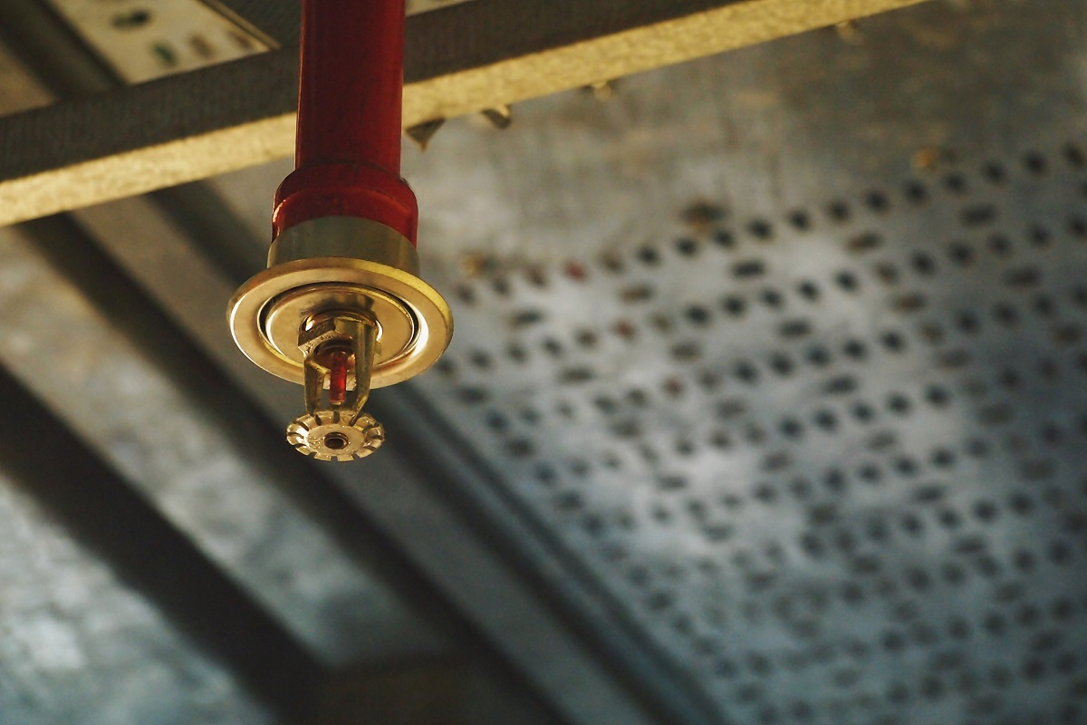 close up picture of a sprinkler inside a building