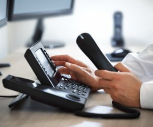 man using a business telephone