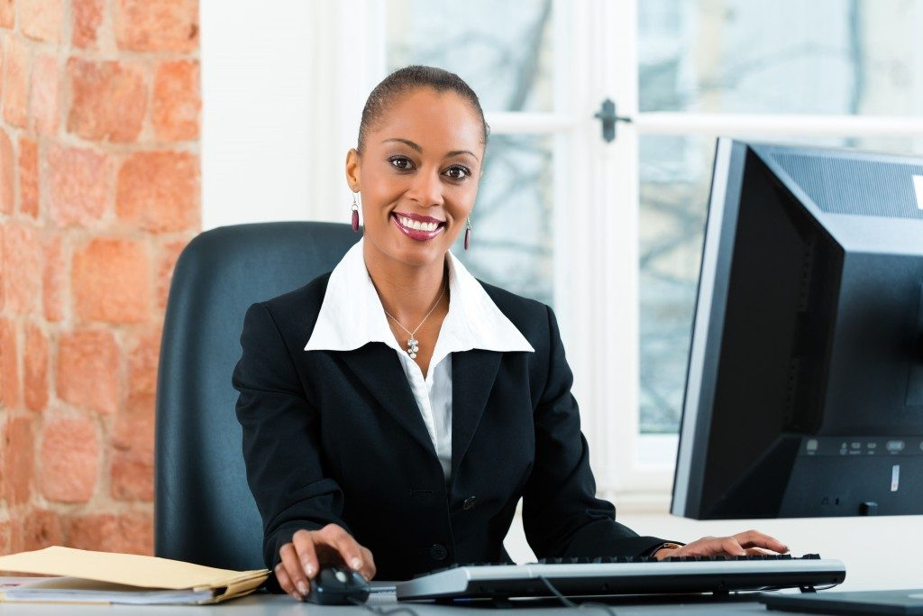 Young female lawyer or paralegal working in her office