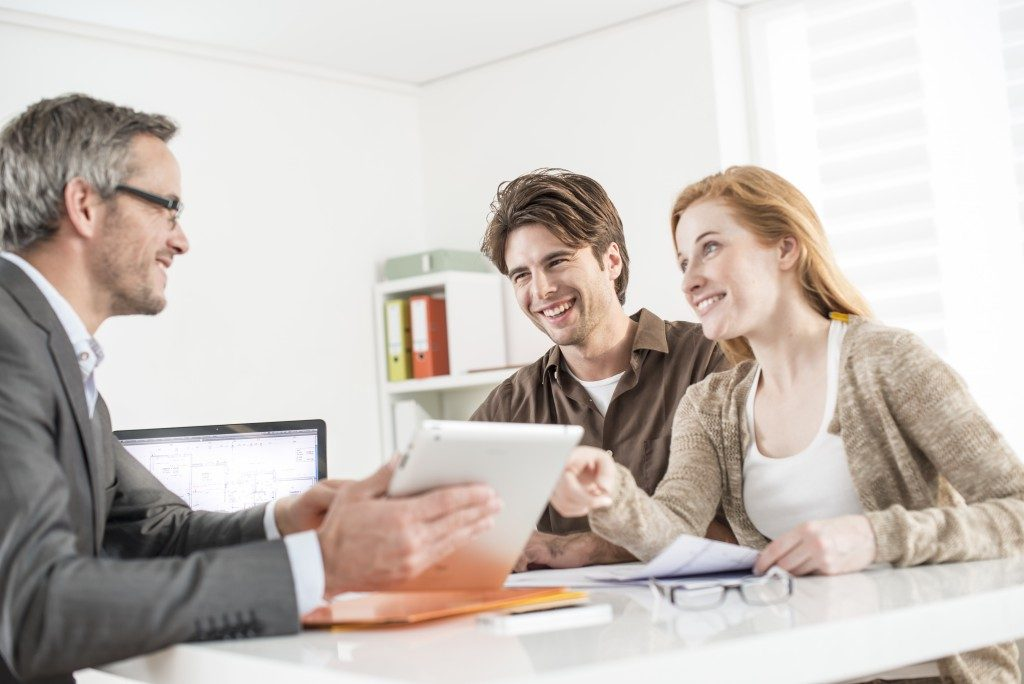 Insurance agent talking to a couple