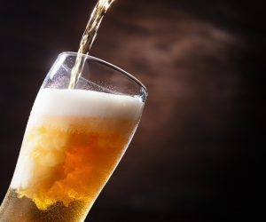 beer pouring on the glass