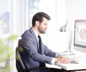 man at his office