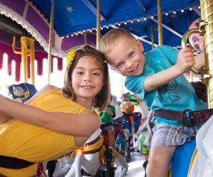 Kids riding a carousel