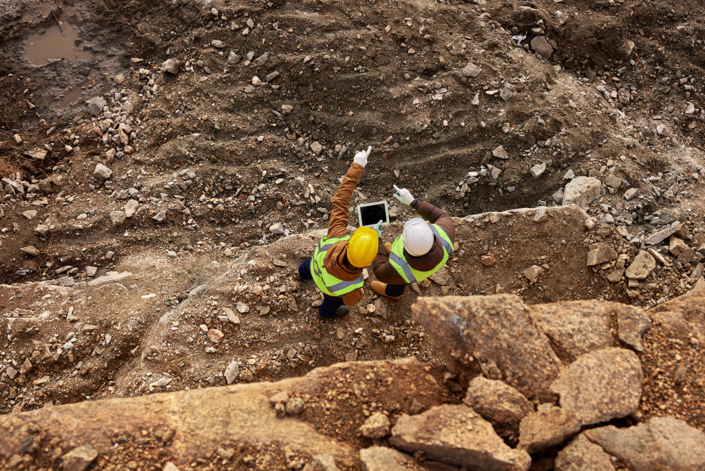 Two workers in quarry pit