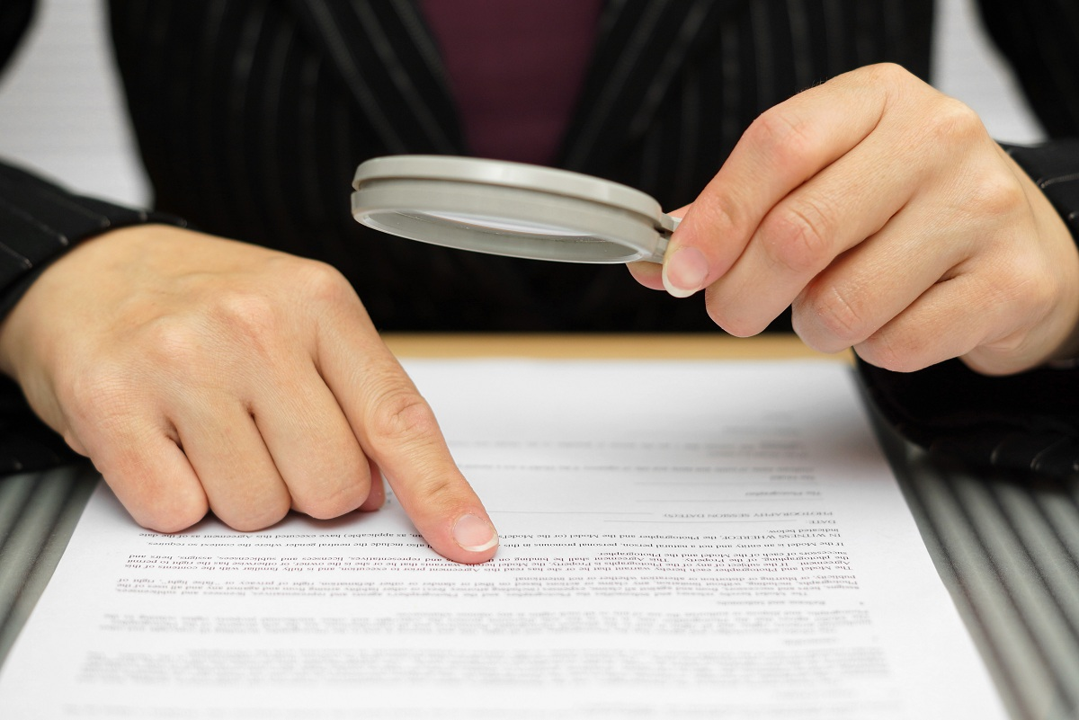 person examining a document