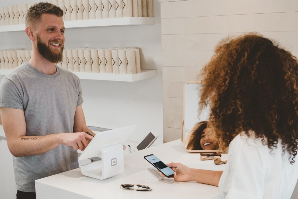 Cashier talking to a customer