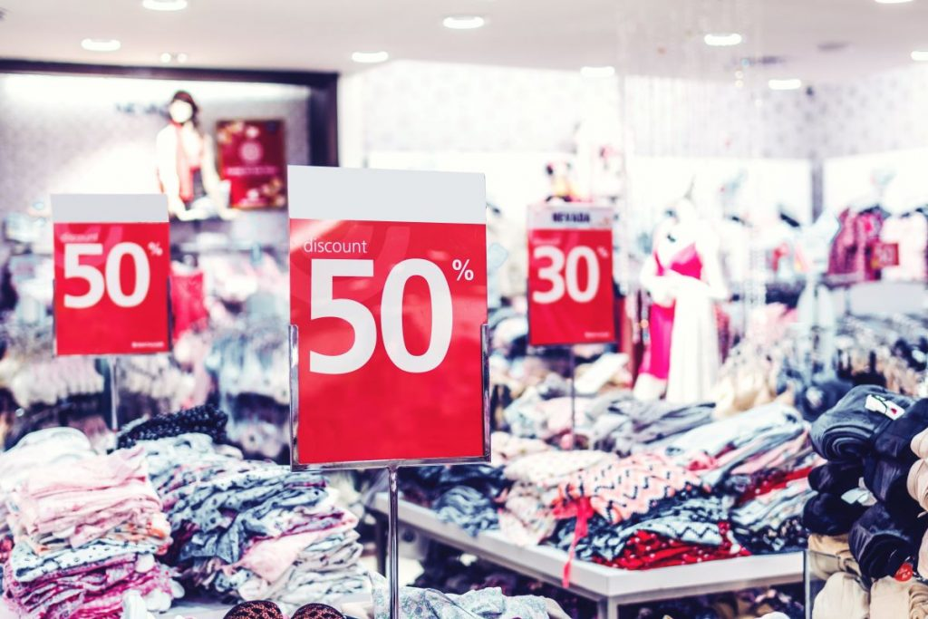discount signs in clothing store