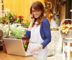 flower shop owner making calls