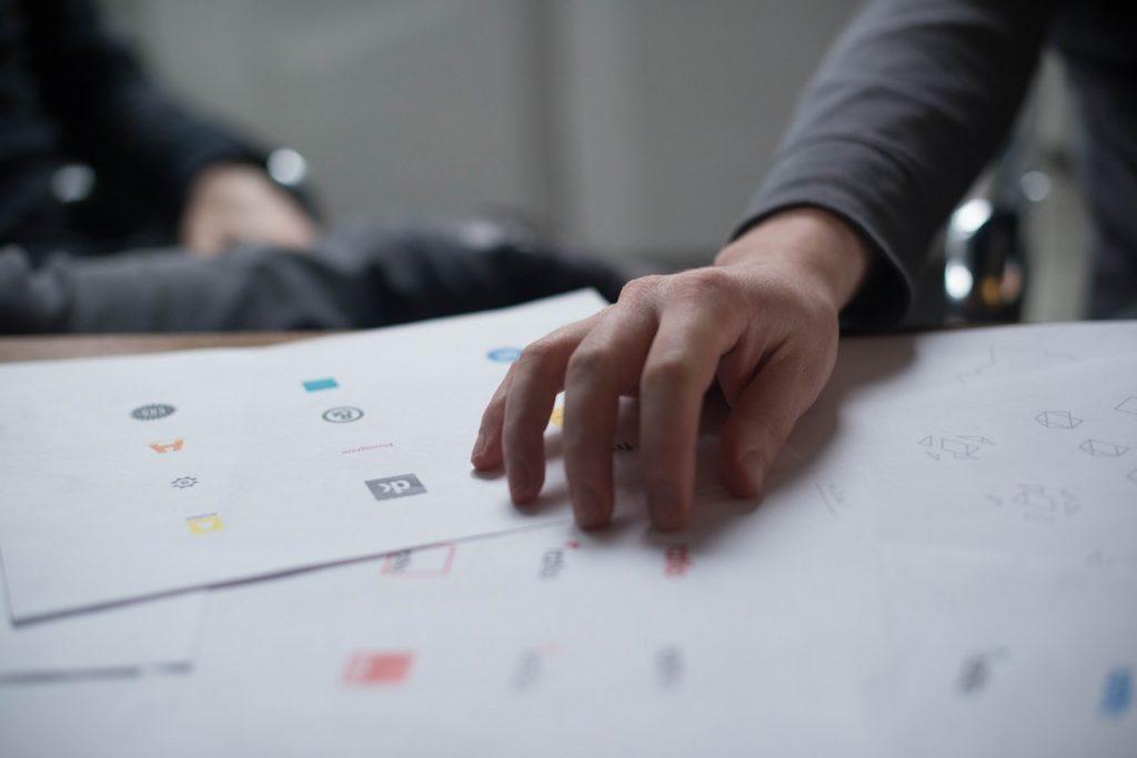 person holding logo design ideas