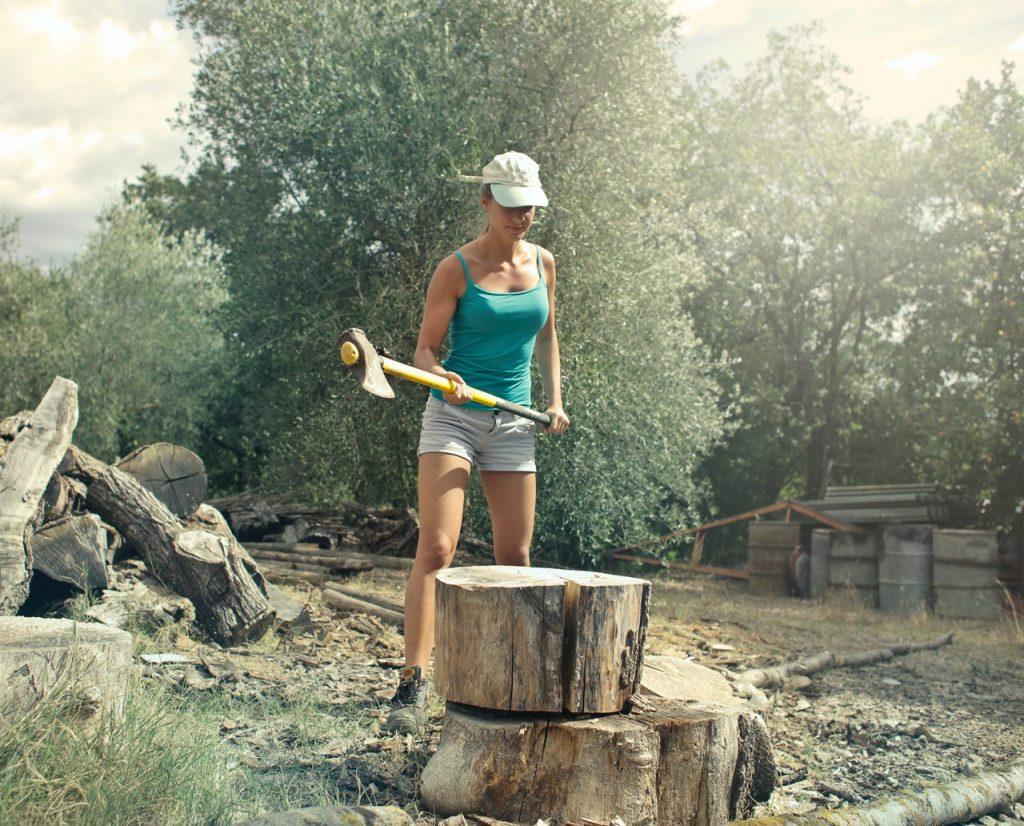 a woman splitting wood
