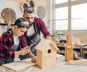 man and son making bird houses