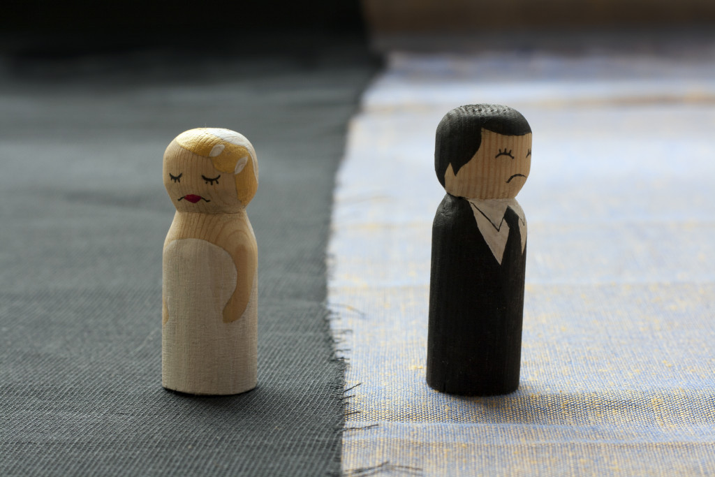 man and woman toy separate