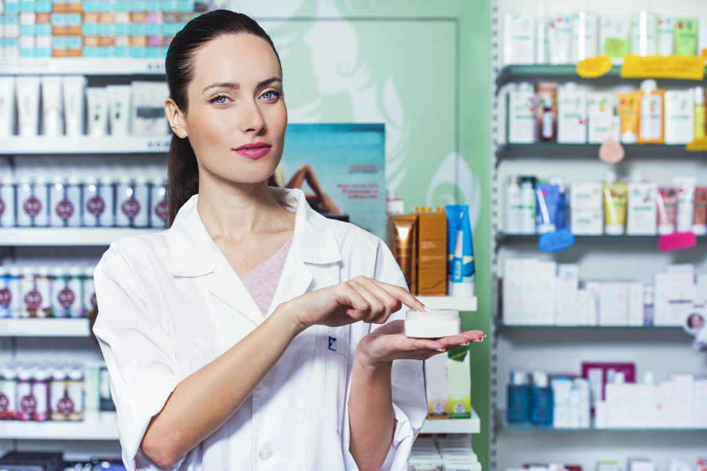 pharmacist holding ointment